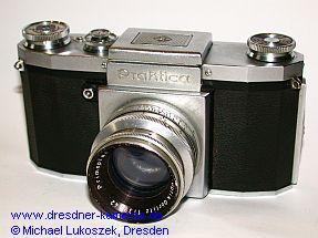 Praktica (1950) mit Meyer Primoplan 1,9/58 - Modell mit eingeschraubten Trageösen