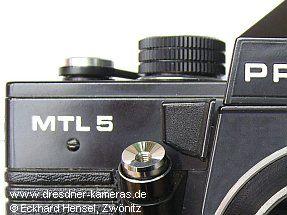 schwarze Deckkappe Praktica MTL 5 (abgebildete Kappe ist echt, Kamera jedoch nicht original)